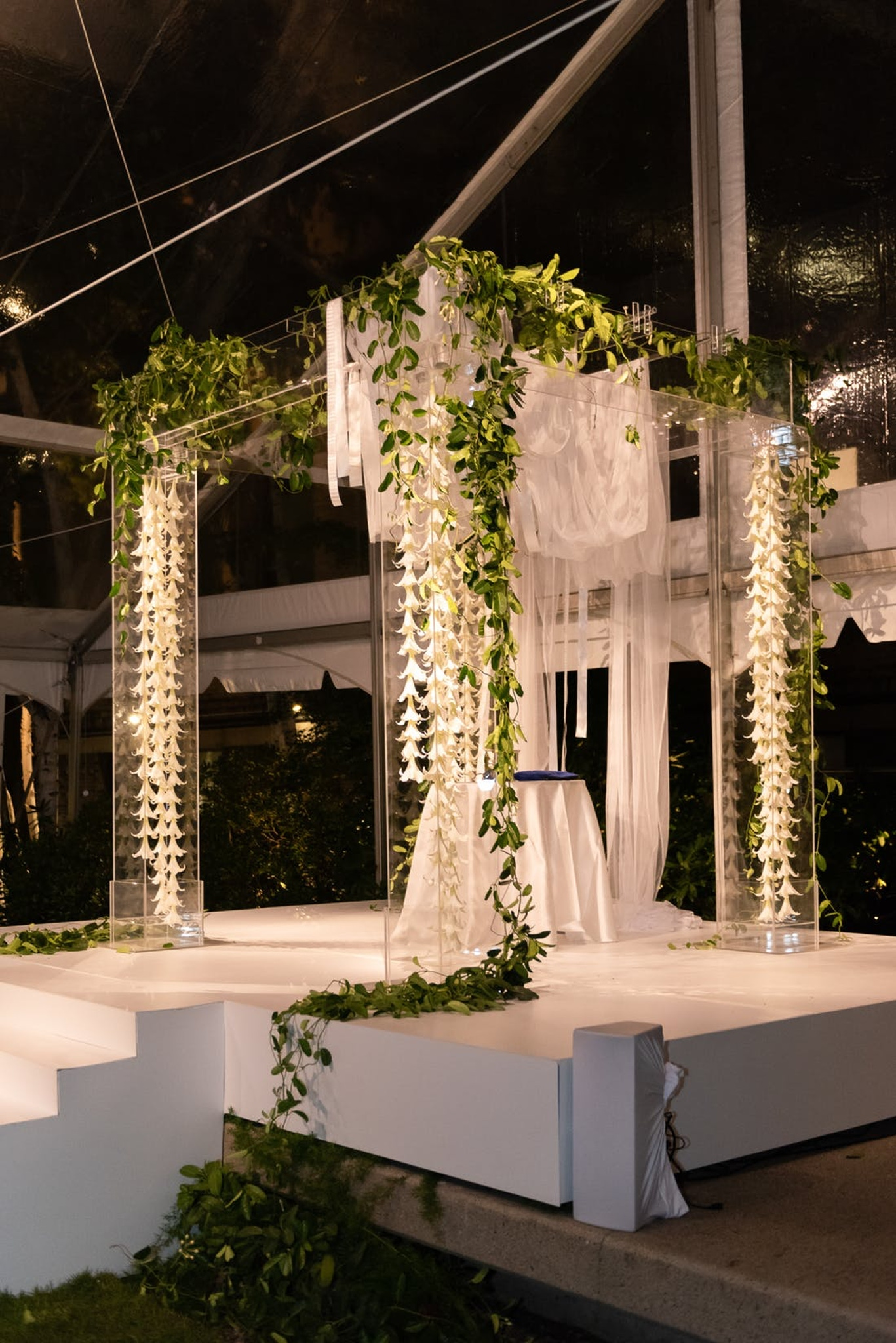 white wedding ceremony Chuppah with greenery