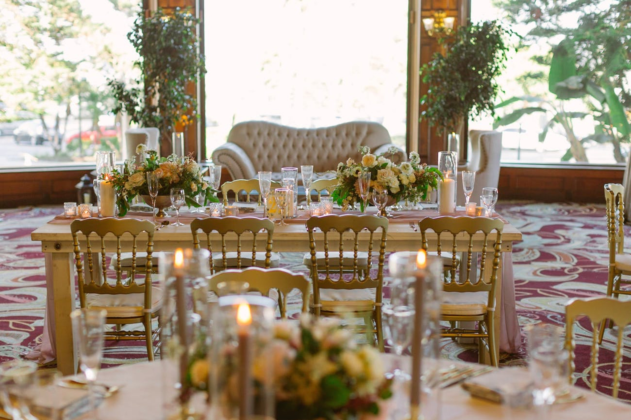 fall wedding reception with neutral tones, couches and yellow floral centerpieces