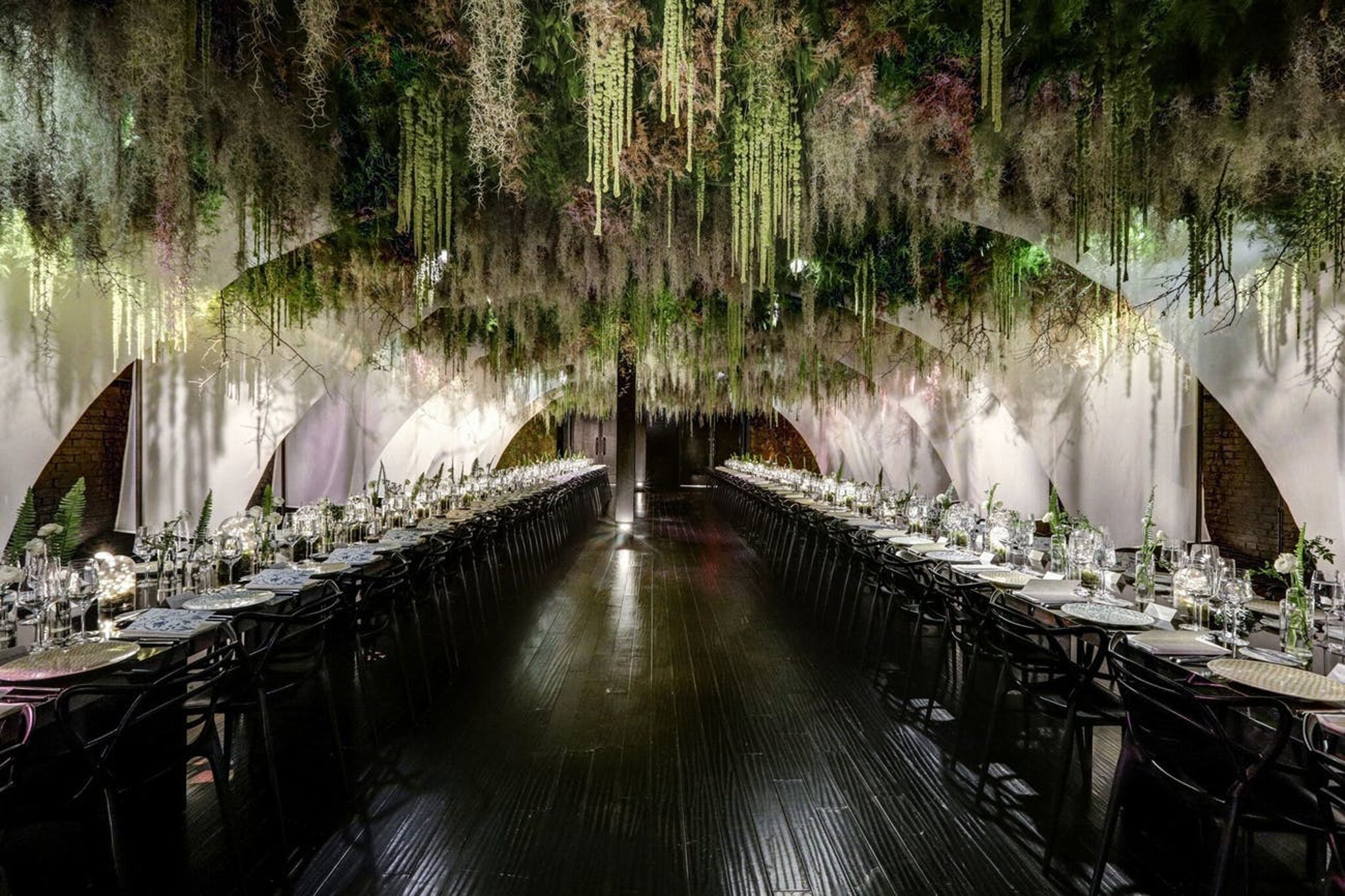 Hermes corporate dinner party with greenery, long tablescapes and black and white décor