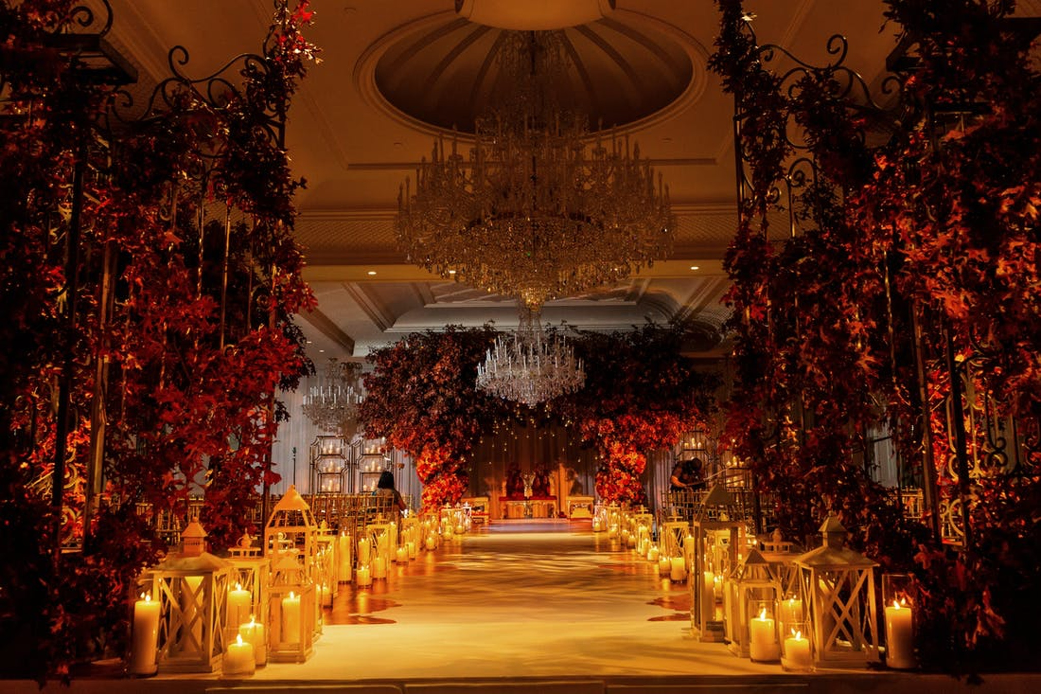luxurious orange wedding ceremony aisle with candles and orange flowers