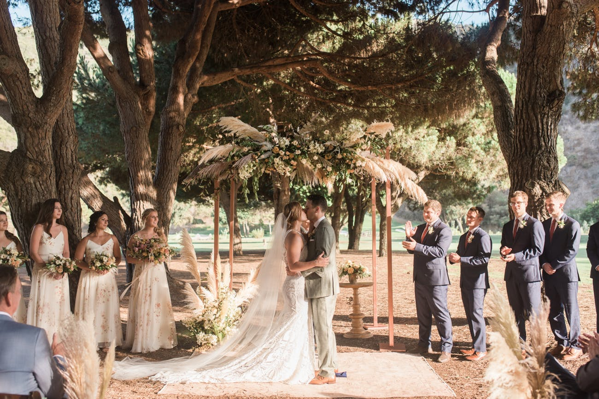 outdoor wedding ceremony with pampas grass