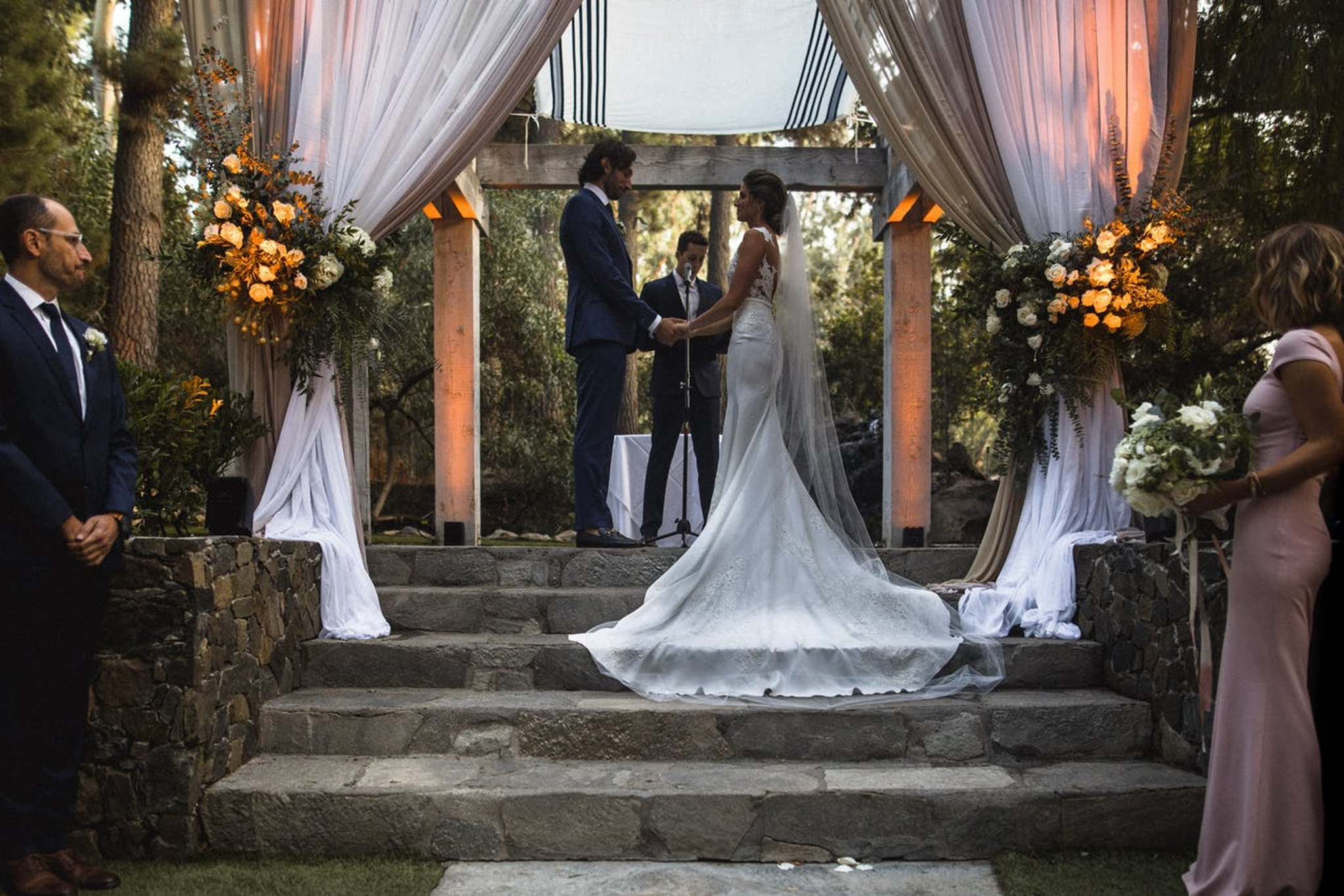 outdoor fall wedding ceremony with white draping and stone steps