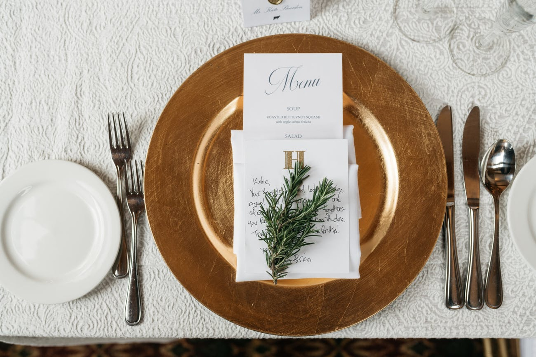 Montage Deer Valley Wedding reception place settings with greenery and white menu and white linens