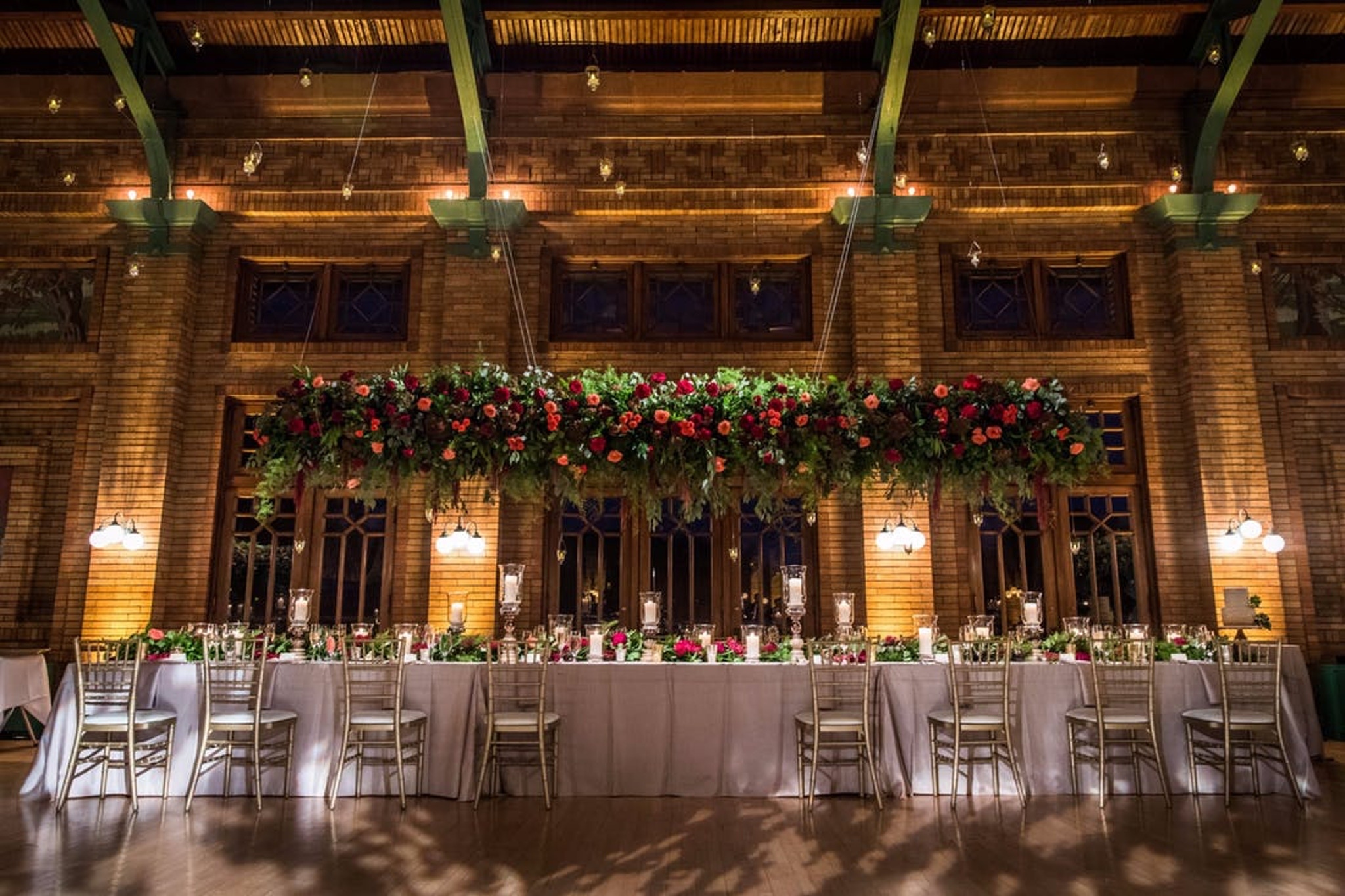 fall wedding reception in Lincoln Park, Chicago at Cafe Brauer with fall décor, greenery and red flowers