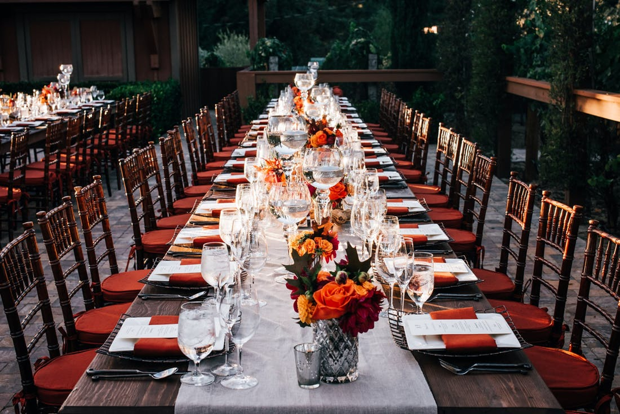 autumn winery wedding with rustic tablescape, orange flowers and burnt orange place settings