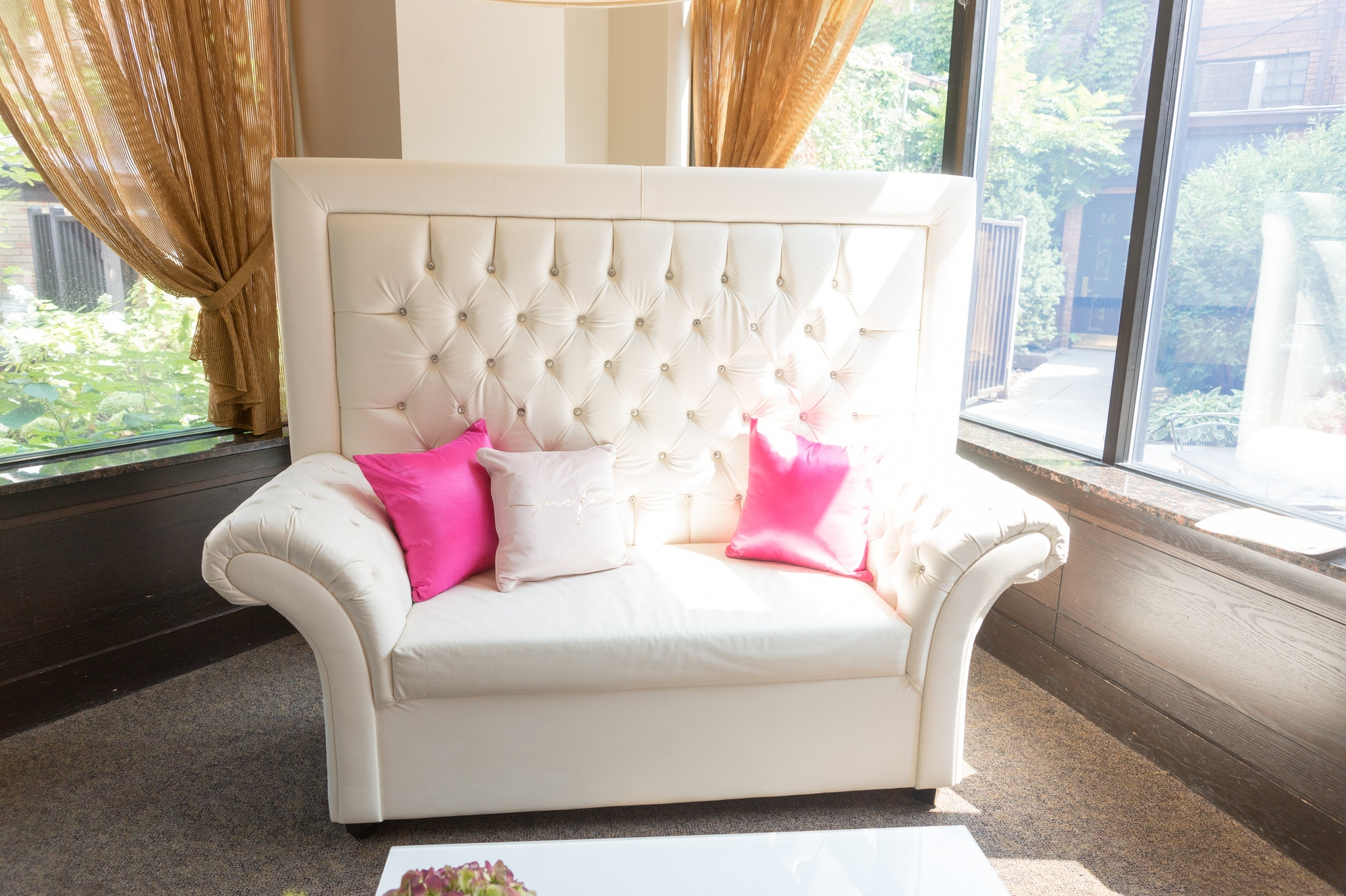 White chair with pink pillows
