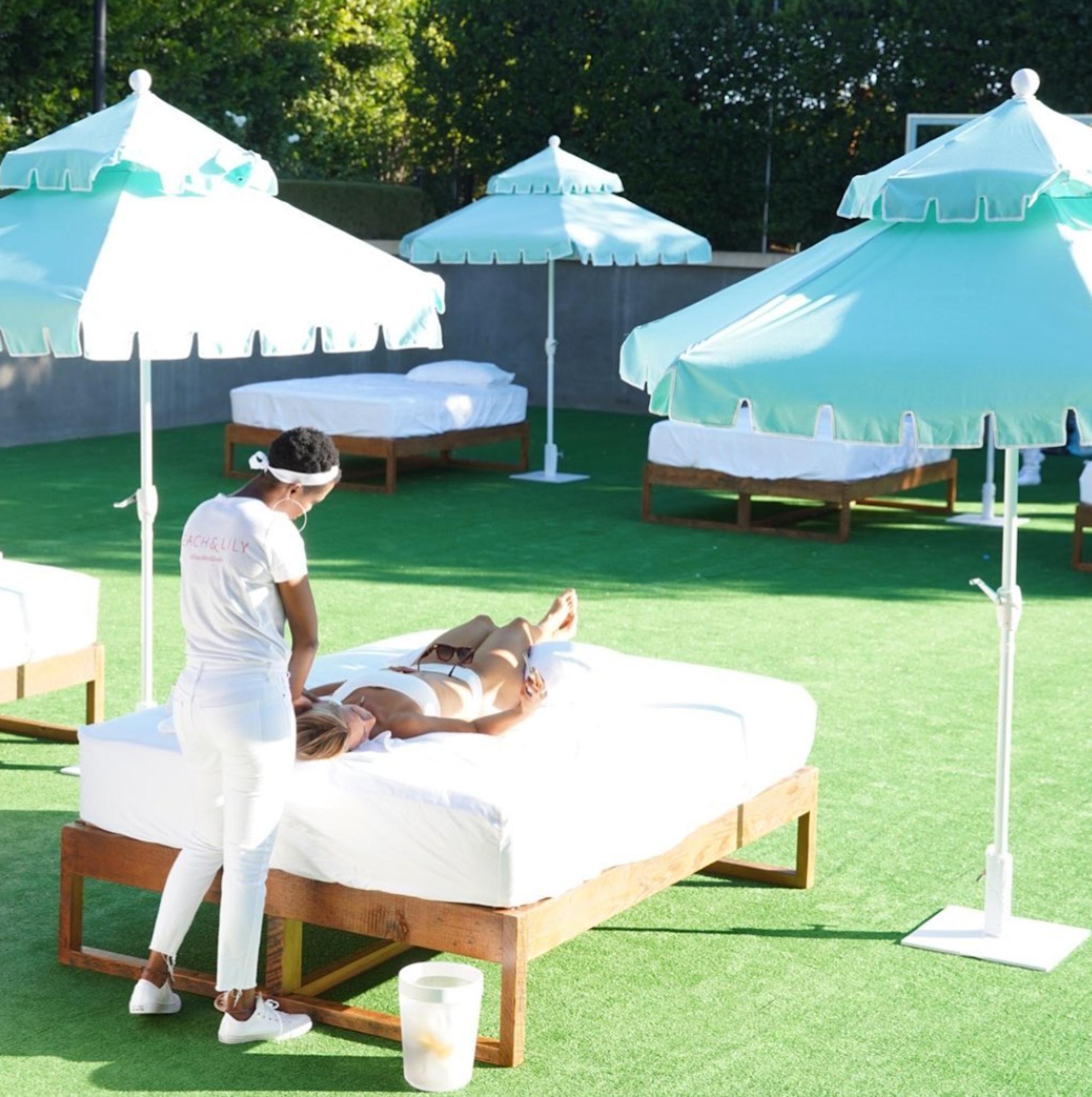Kourtney Kardashian Poosh event massage tables on tennis court