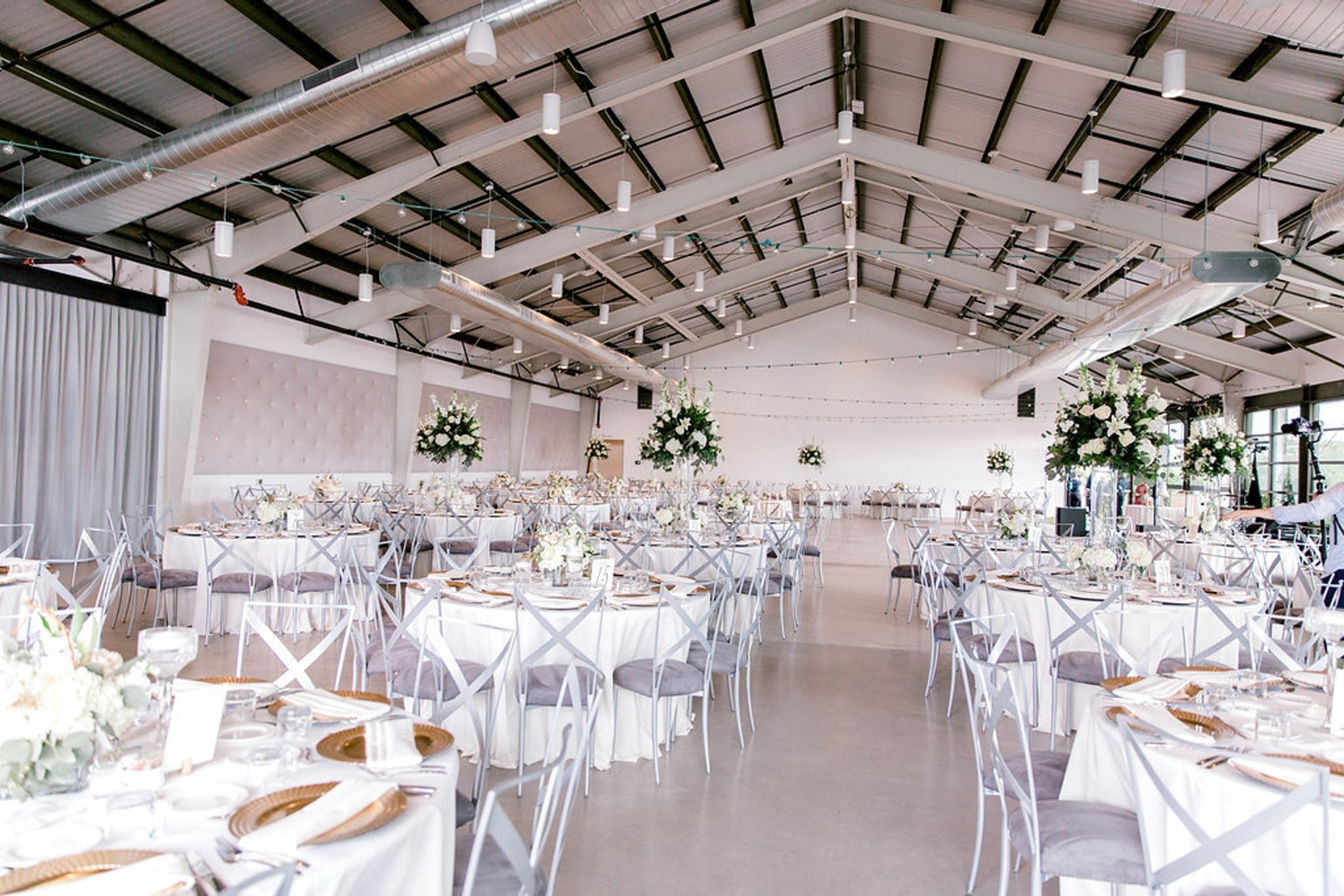 The Clayton House wedding reception with white tables and floral centerpieces