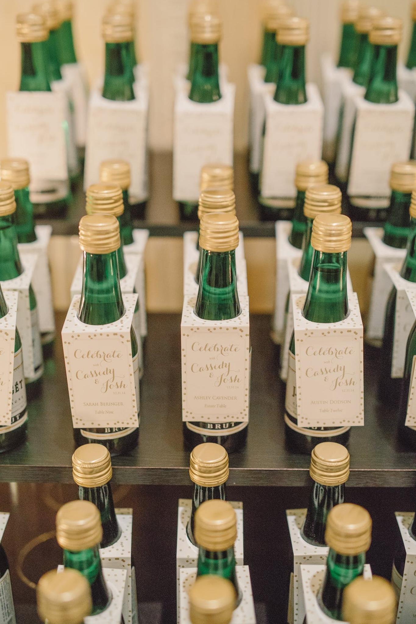 mini champagne bottle escort cards at nye wedding