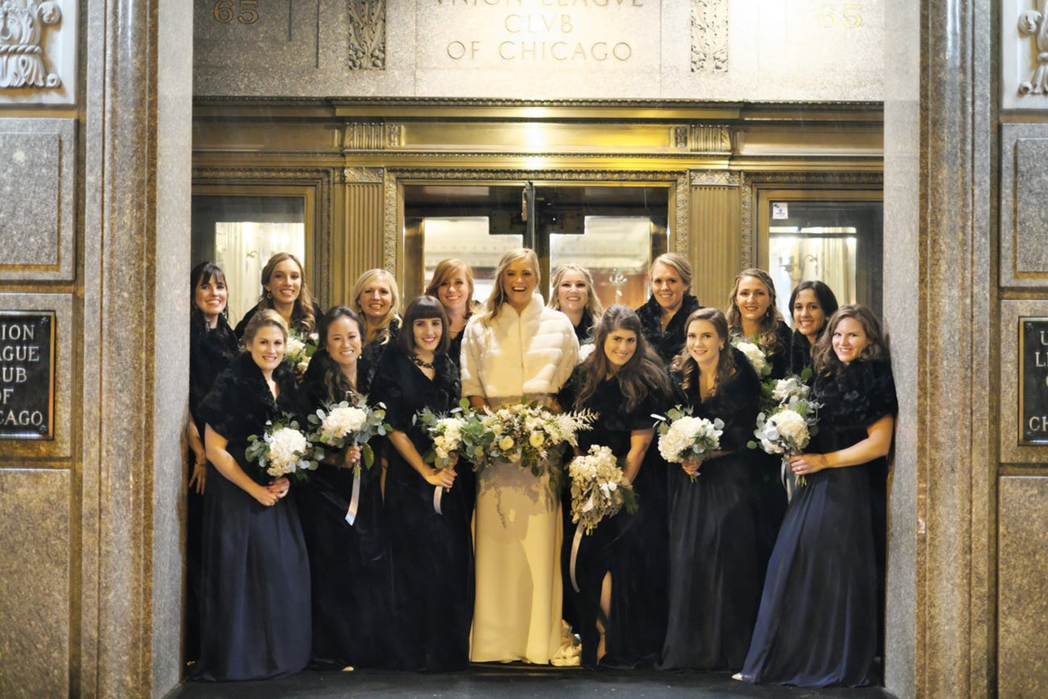 bridal party and bride outside in chicago during the winter for wedding portraits