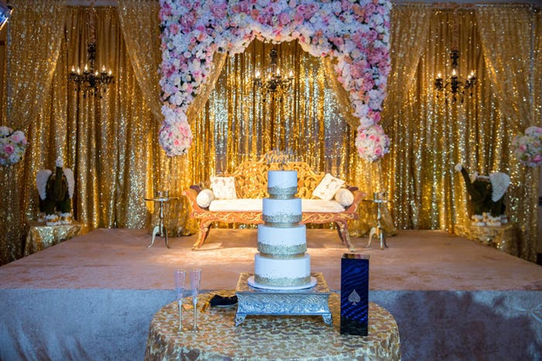 wedding cake surrounded by gold accents