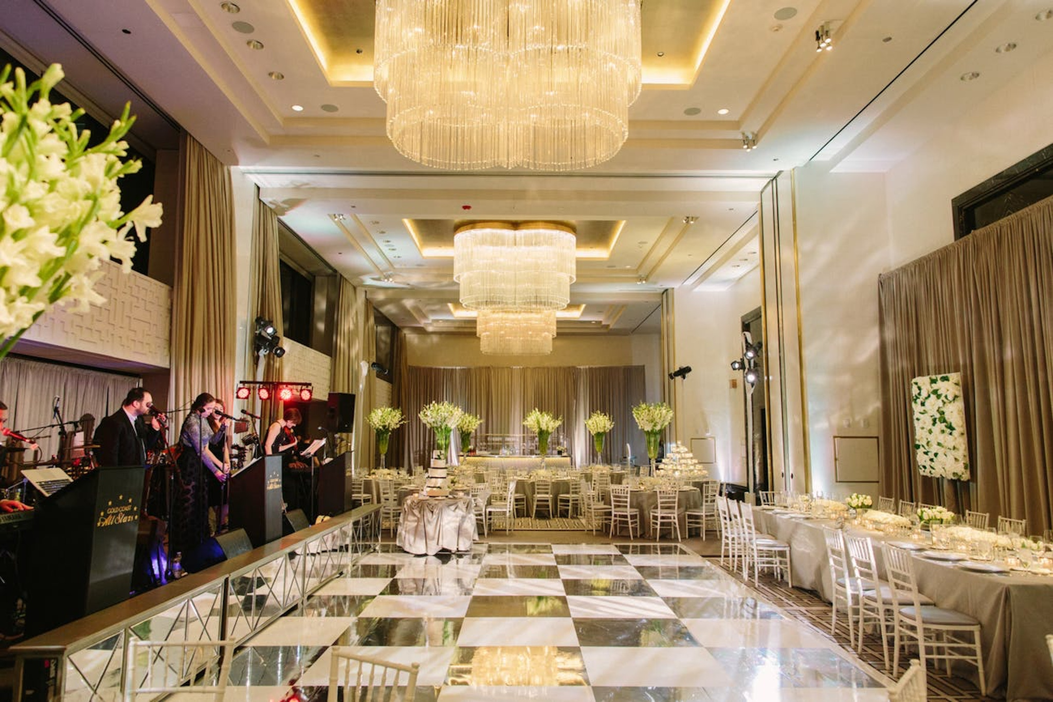 The Langham Chicago ballroom set up for a new years eve wedding with dance floor and reception set up