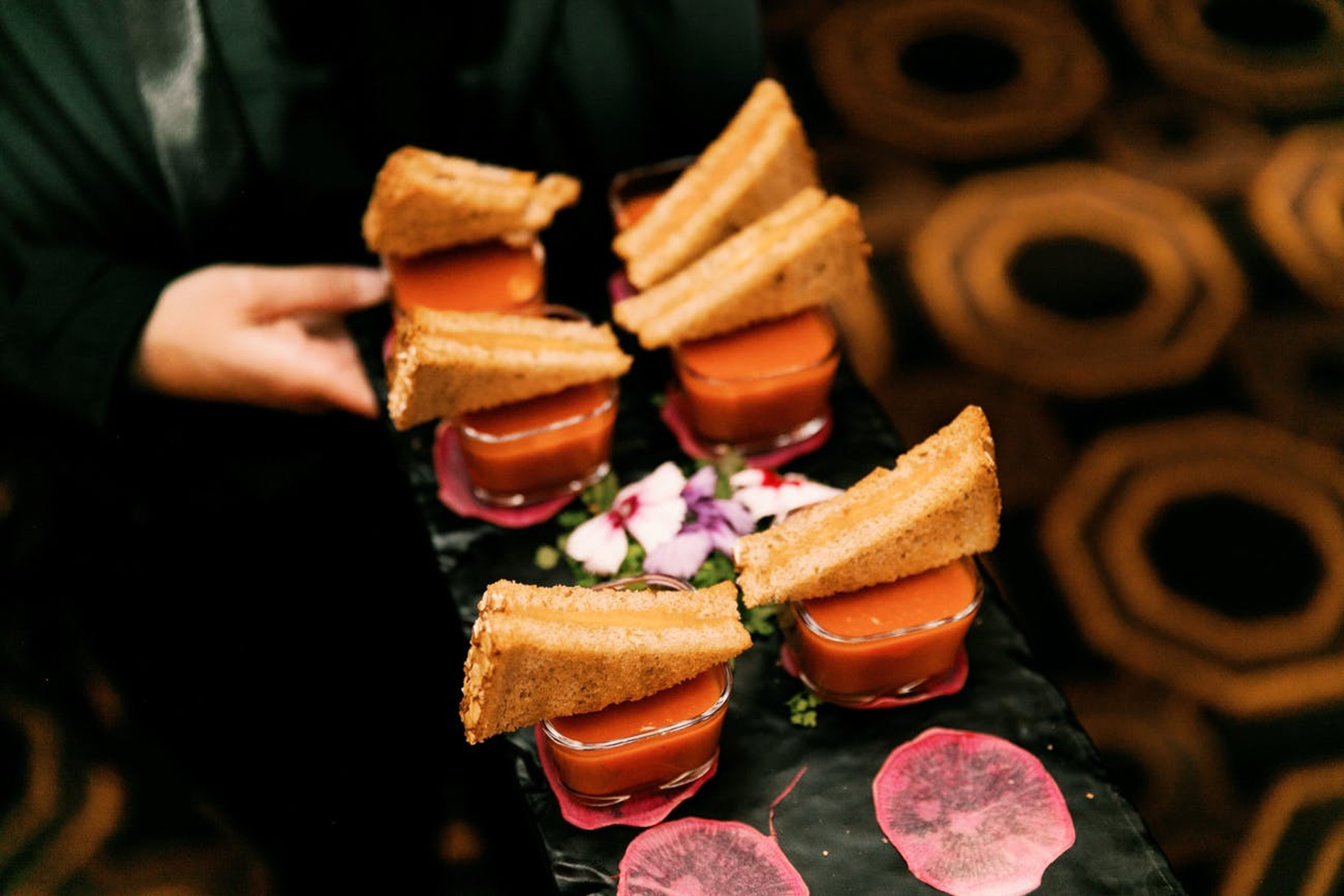 mini grilled cheese and tomato soup passed appetizers at a nye wedding cocktail hour