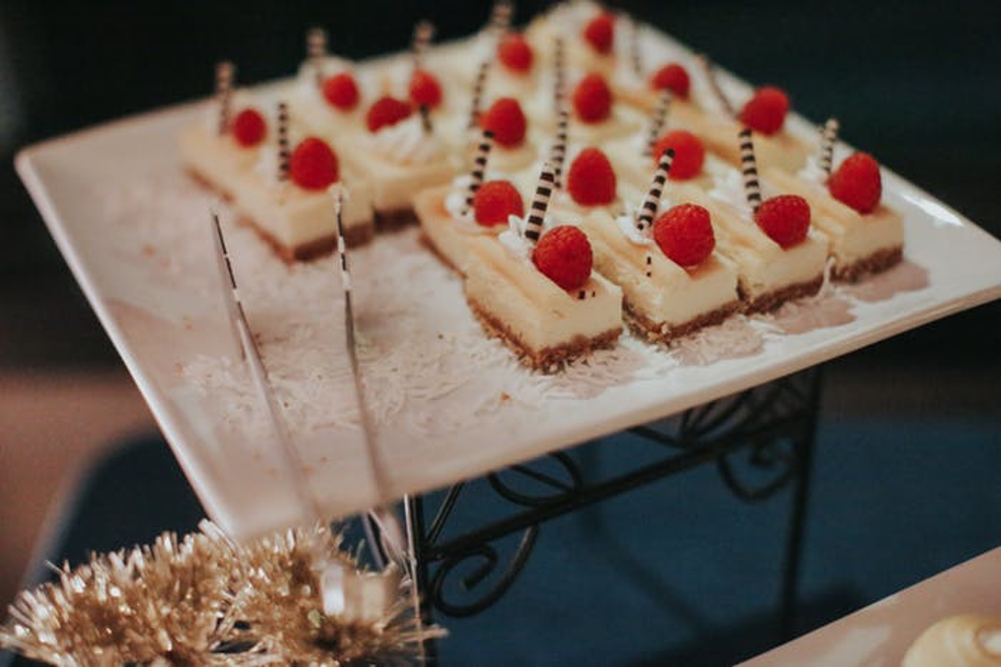 desserts topped with raspberries