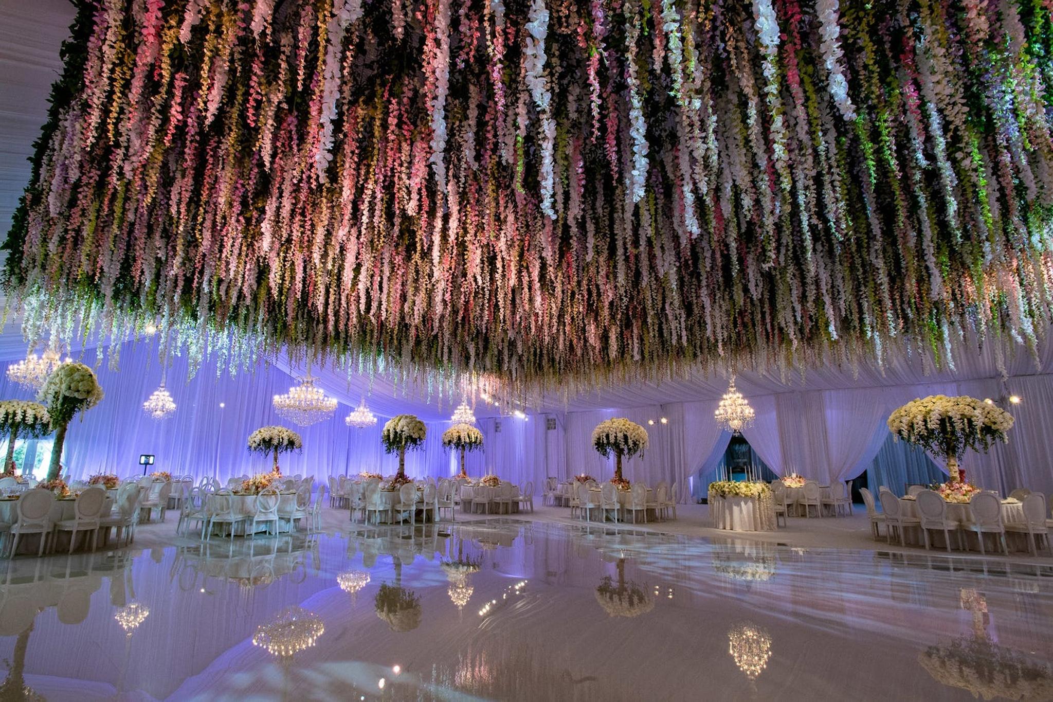floral fringe filling the ceiling of a wedding dance floor