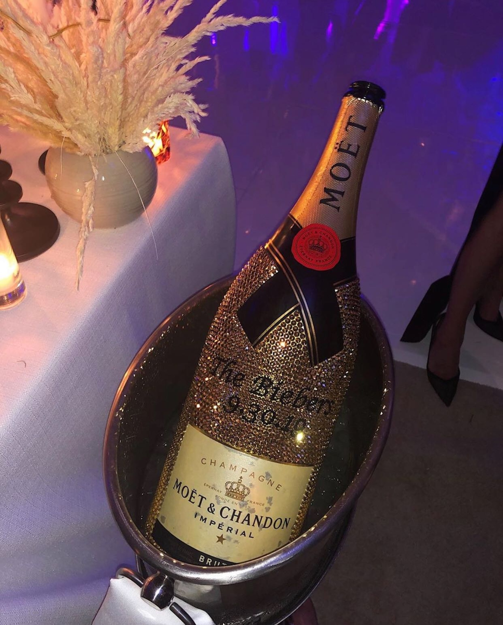 gold custom Moet bottle from Justin and Hailey Biebers wedding reception