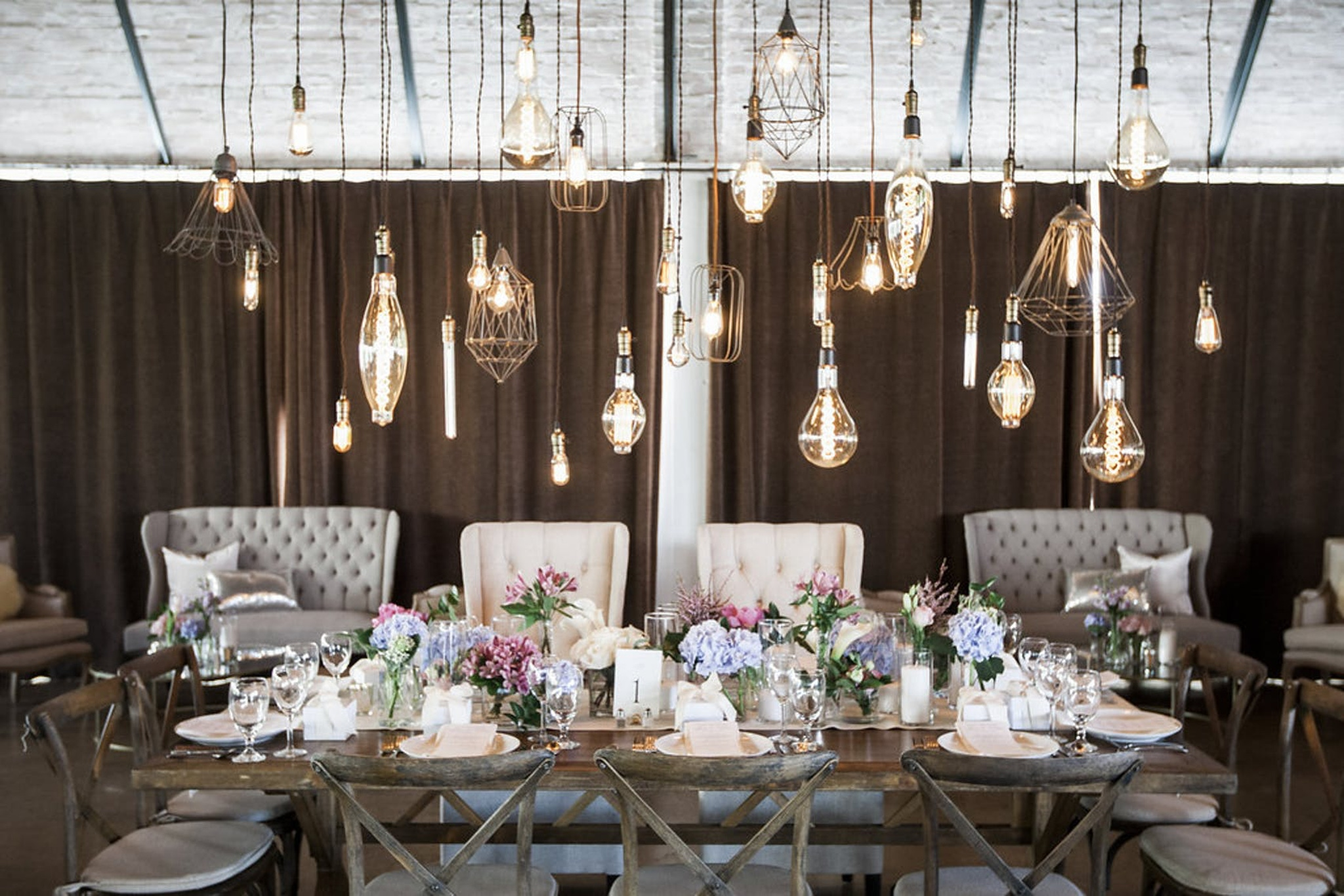 long lanterns hanging over table