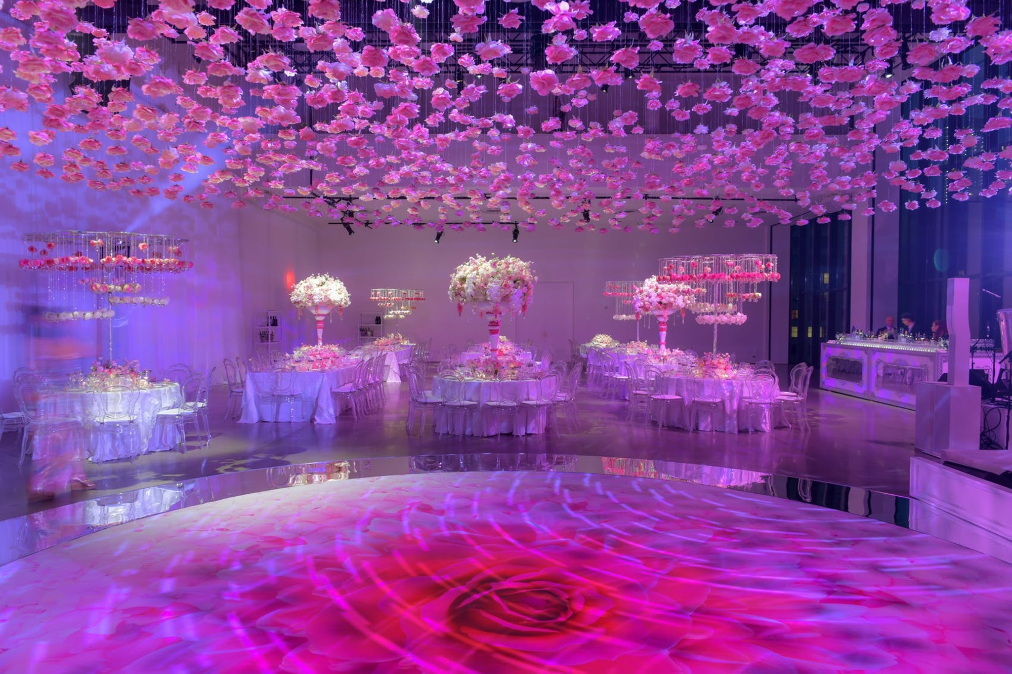 pink and purple balloons suspended from the ceiling