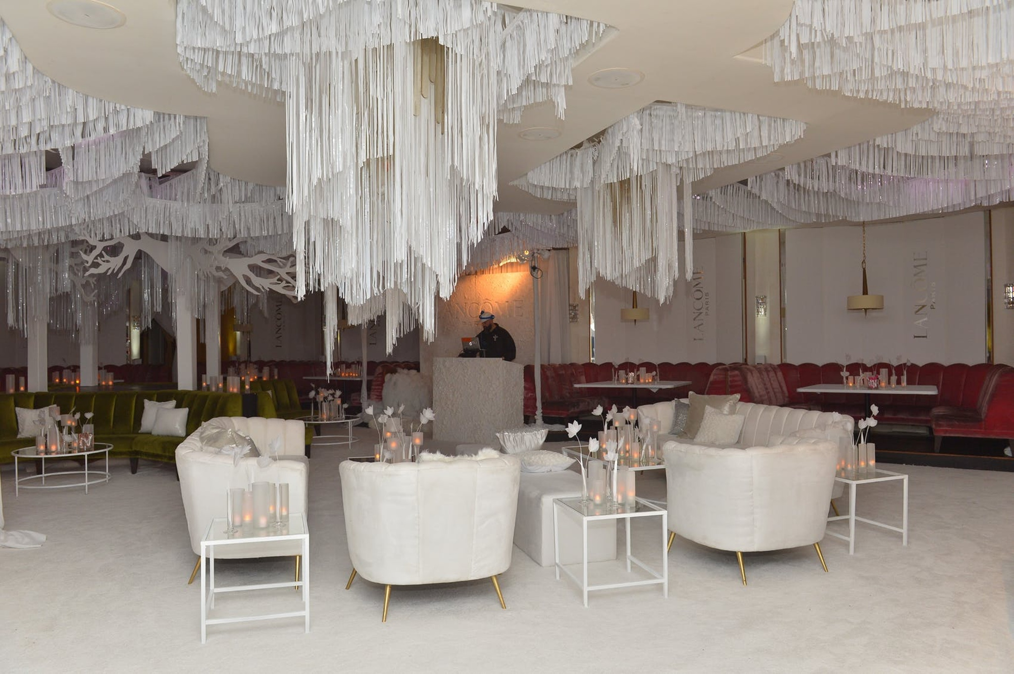 white hanging strings over white lounge area