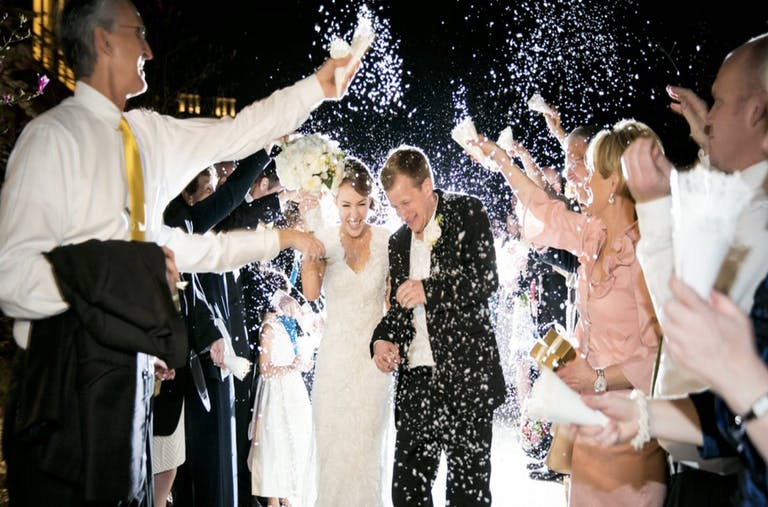 Bride and groom exiting during rice toss