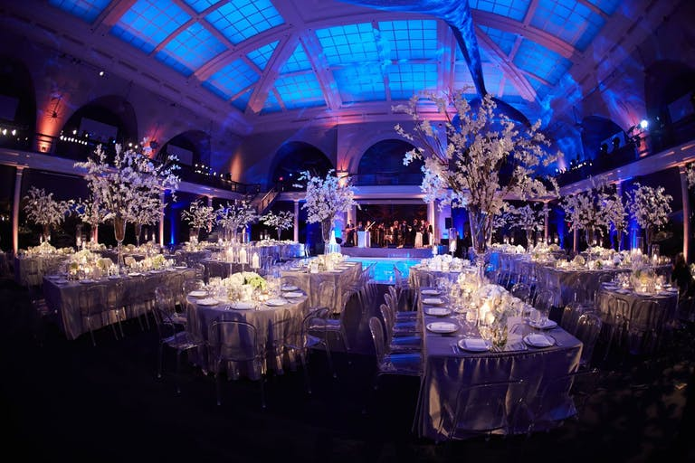 New York Ballroom with skylight and white florals | PartySlate