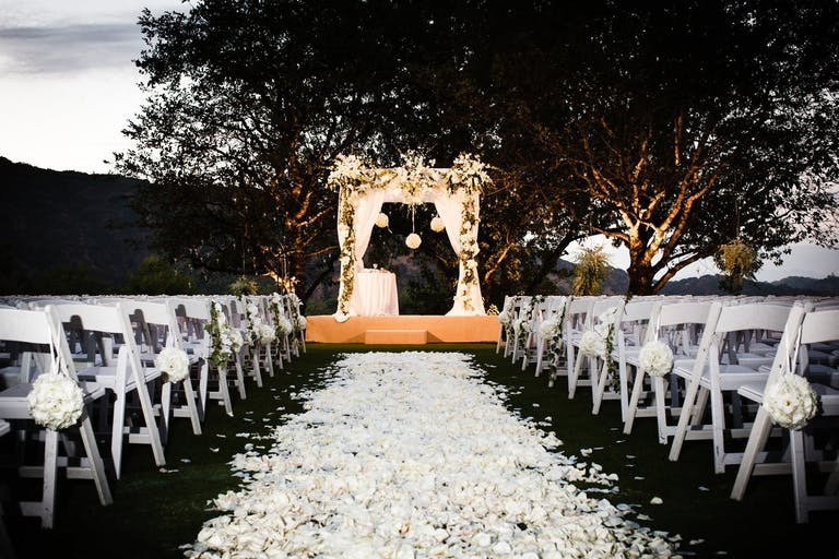 Outdoor ceremonial space with white petal walkway