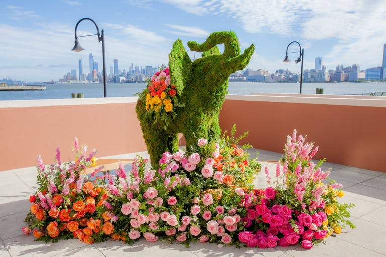 Elephant boxwood wedding sculpture with colorful florals | PartySlate