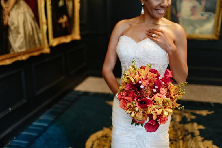 cropped portrait of bride with vibrant bouquet