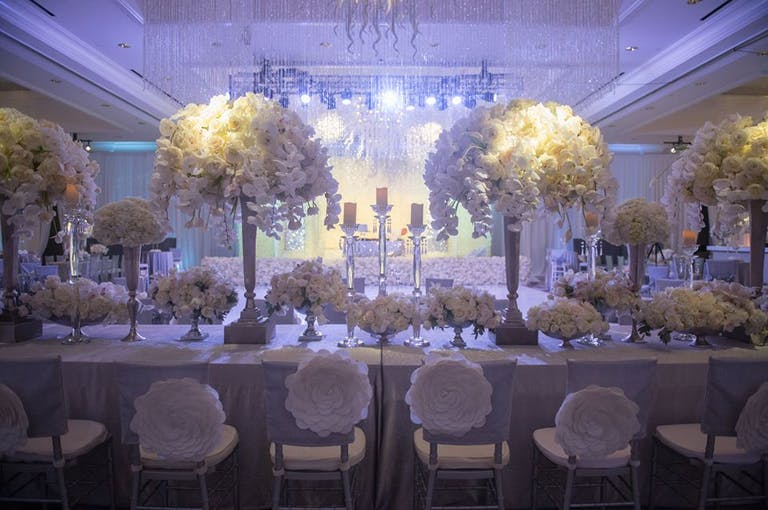Ballroom with all-white décor and blooms