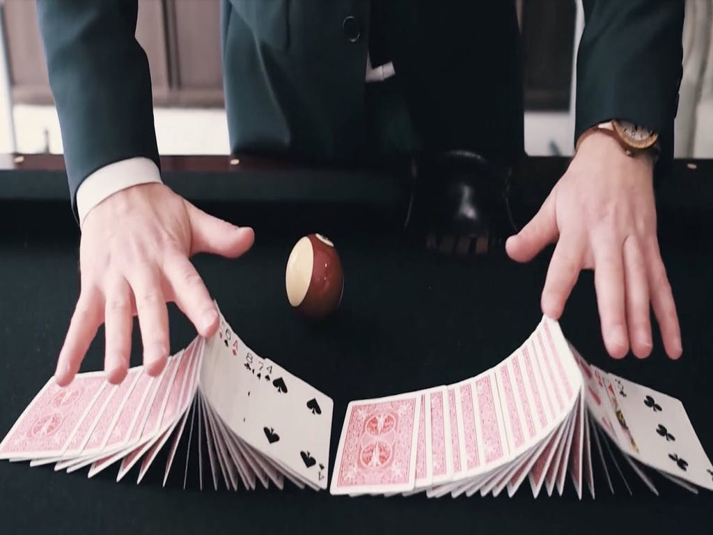 cropped photo of man shuffling cards
