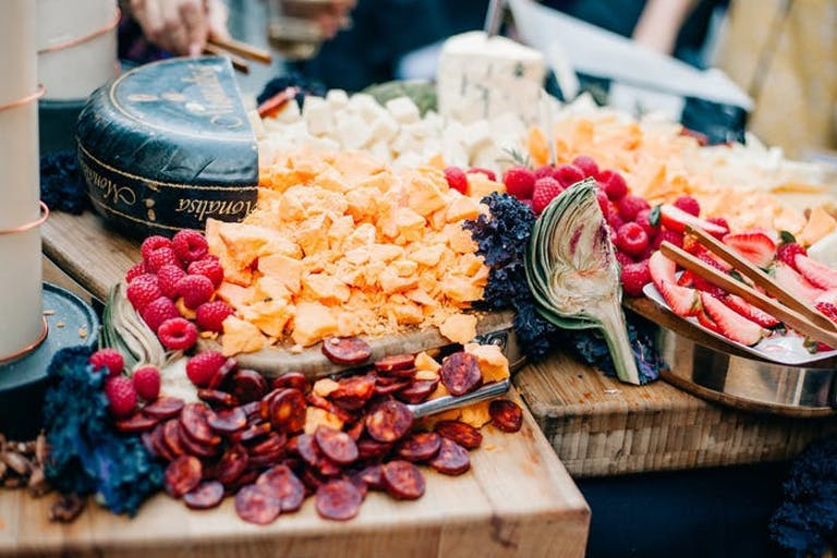 Overflowing cheese and fruit board   PartySlate