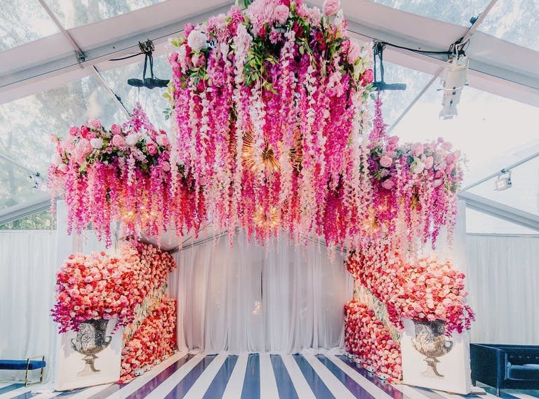 Ceremony alter with suspended pink blooms
