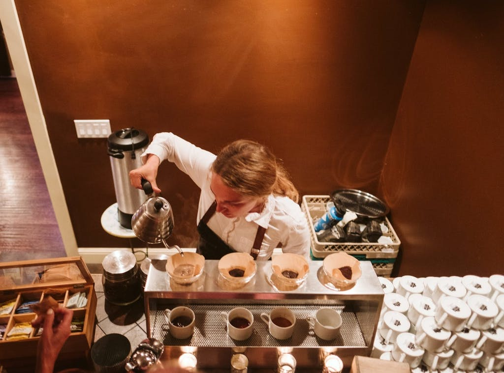 Female barista making pour-overs
