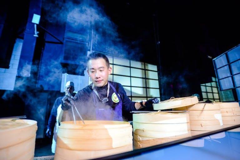Chef making steaming dumplings   PartySlate