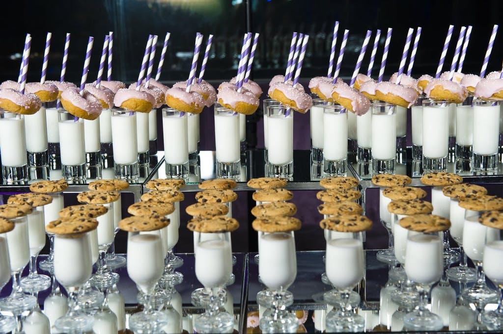 Desert station of cookies, donuts, and milk | PartySlate