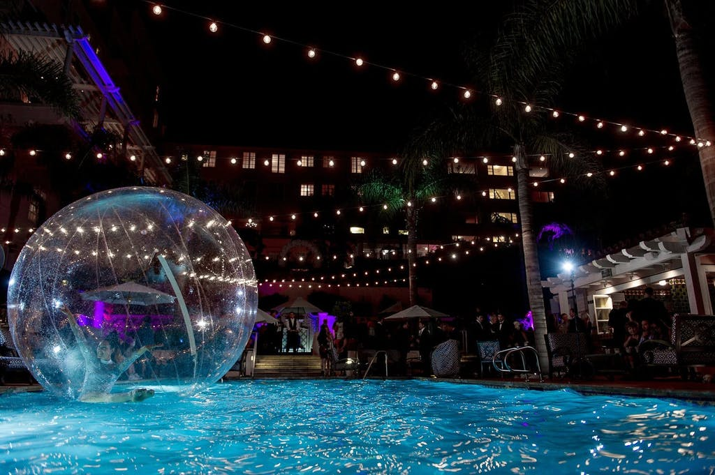 Bubble dancer performing in AcroShere on pool