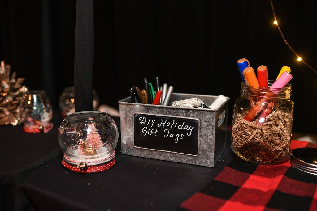 crafting station for snow globes and holiday gift tags | PartySlate