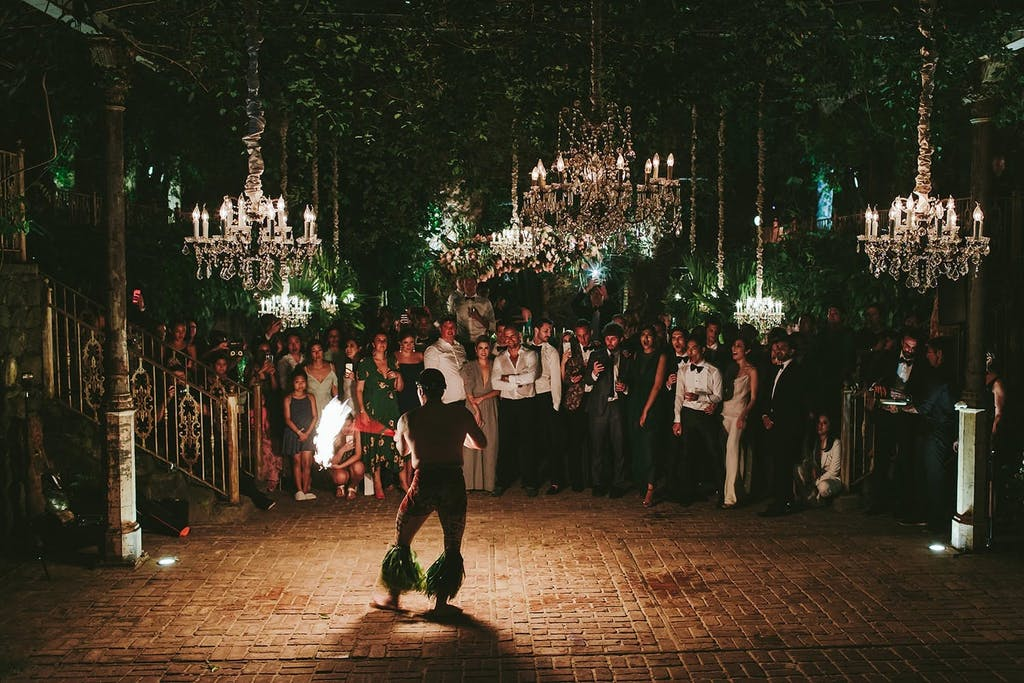 fire dancer performing at wedding