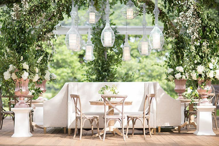Intimate dining area with suspended, globed lighting