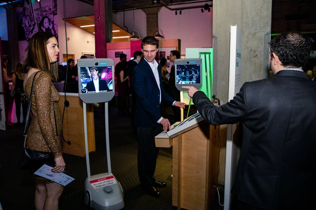 Guests interacting with iPad selfie station | PartySlate