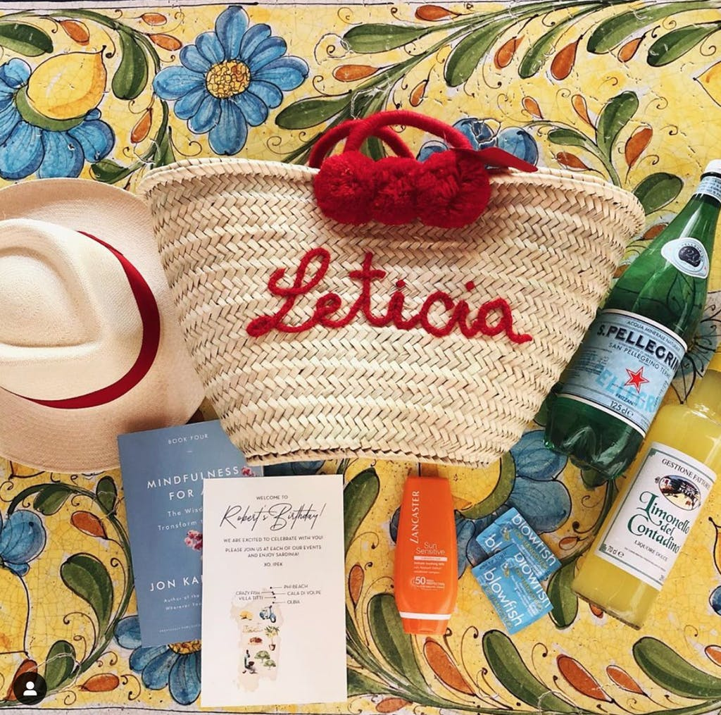Custom-made tote bag with hat, sparkling beverages, and sun block.