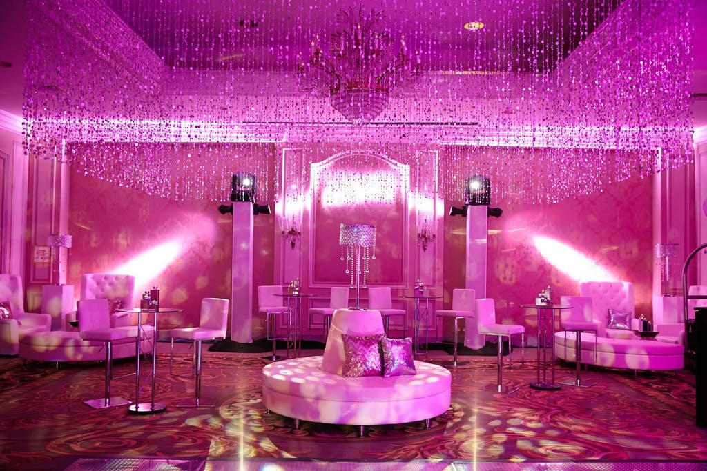 Dance floor with pink uplighting and lounge area
