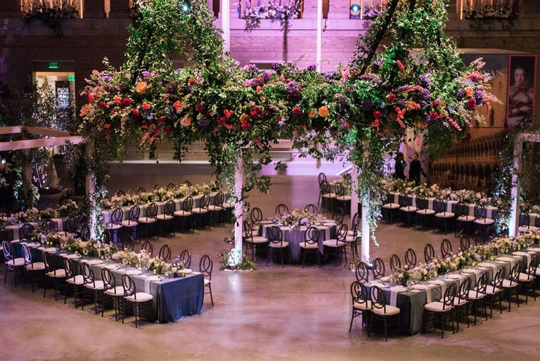 reception area with diamond table formations and lavish foliage