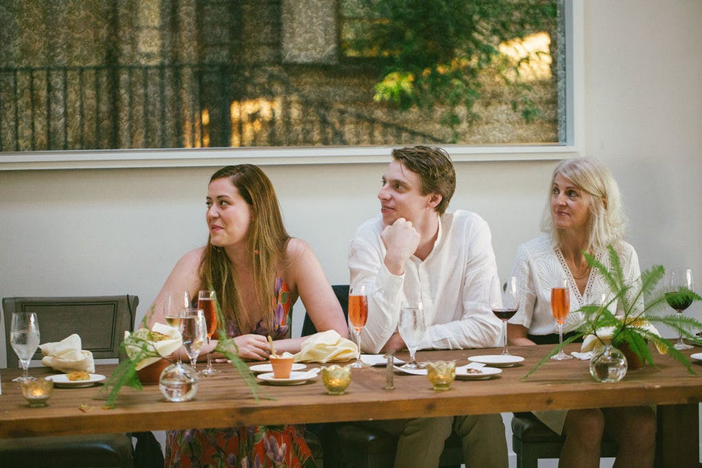 Three guests drinking rosé at a wedding rehearsal dinner   PartySlate