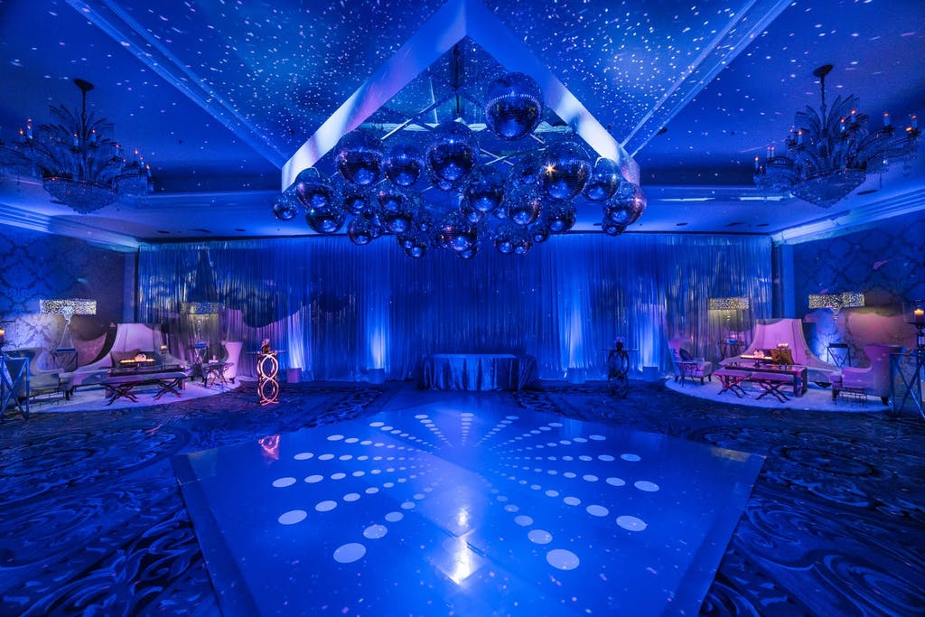 Dance floor with blue uplighting and snowflake projection mapping