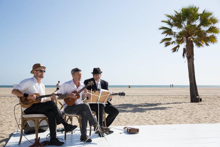 Jazz trio playing on beach