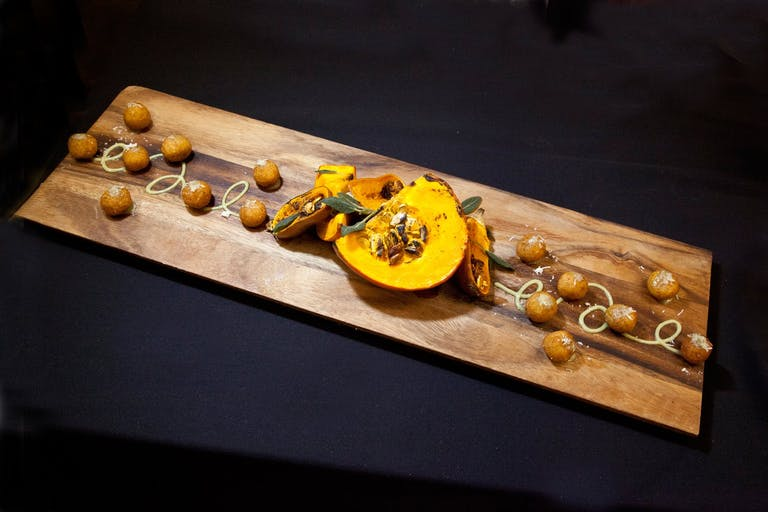 Squash and walnuts on wooden serving tray