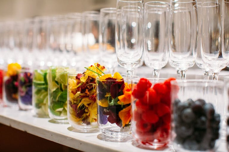 wine glasses with an assortment of colorful fruit garnishes