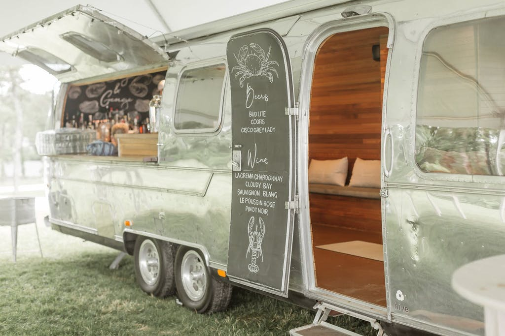 Airstream bar at an outdoor wedding rehearsal dinner   PartySlate