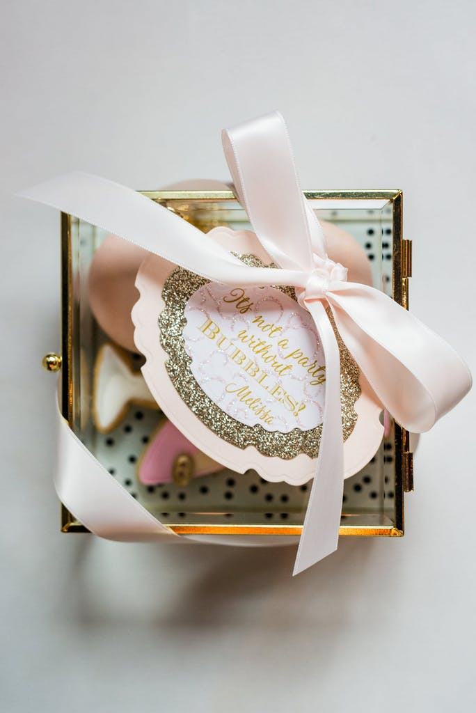 Champagne-flavored take-home cookies and pretty packaging for birthday party favor